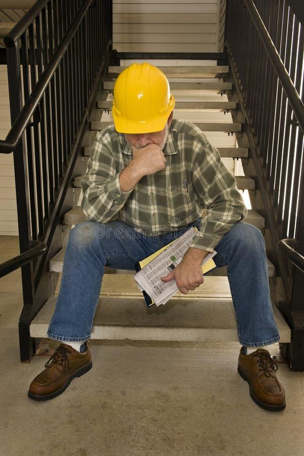 Lagt av byggnadsarbetare arkivfoton