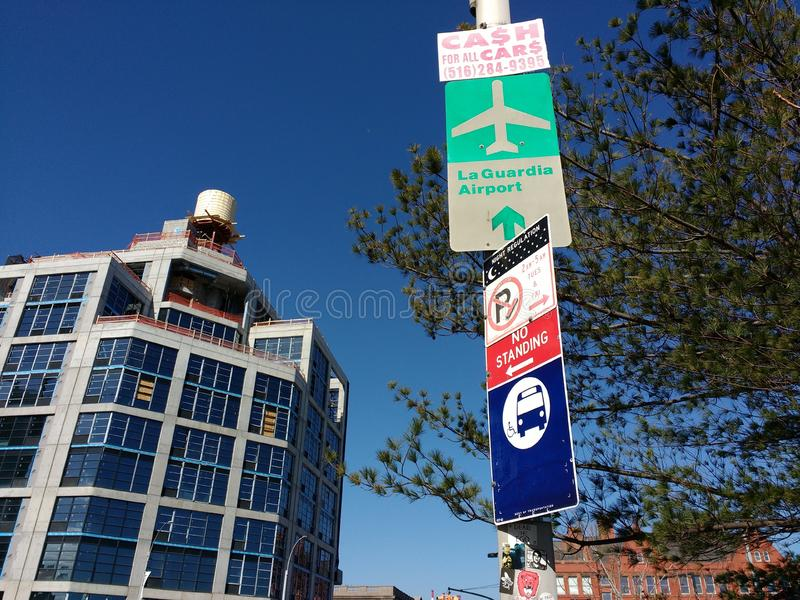 LaGuardia Airport Sign, LIC, Queens, NY, USA. A street sign for LaGuardia Airport, LGA, on 21st Street. This photo was taken near the corner of Jackson Avenue royalty free stock images