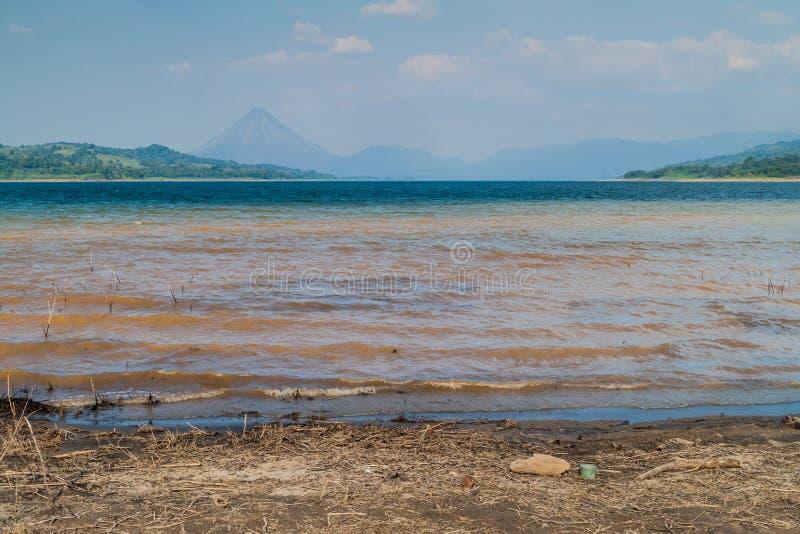 Laguna de Arenal reservoir, Costa Rica. Arenal volcano in the backgroun royalty free stock photo
