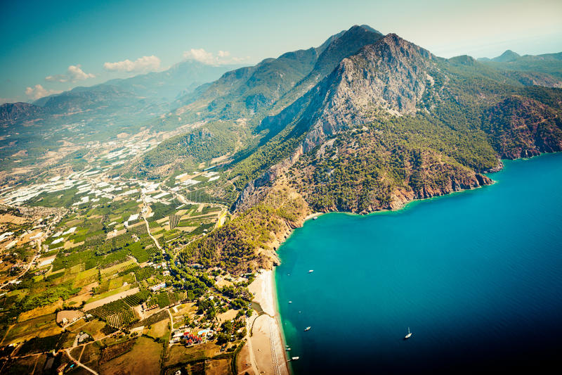 Laguna with mountain view from paragliding at sea from air. Summer time view to laguna from air in Turkey stock images