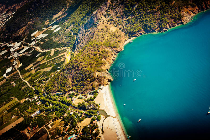 Laguna with mountain view from paragliding. Summer time laguna in Turkey from air stock image