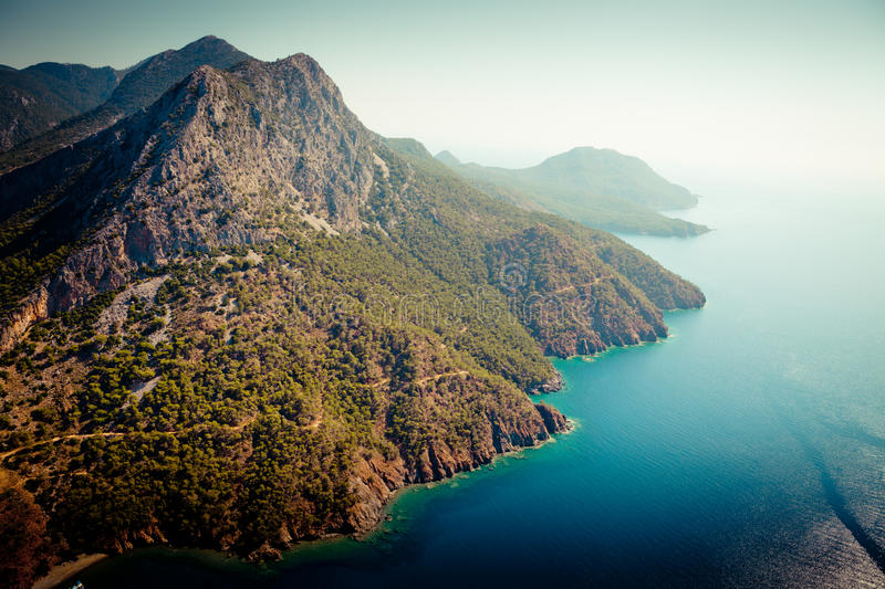 Laguna with mountain view from paragliding. Summer time laguna in Turkey from air royalty free stock photos