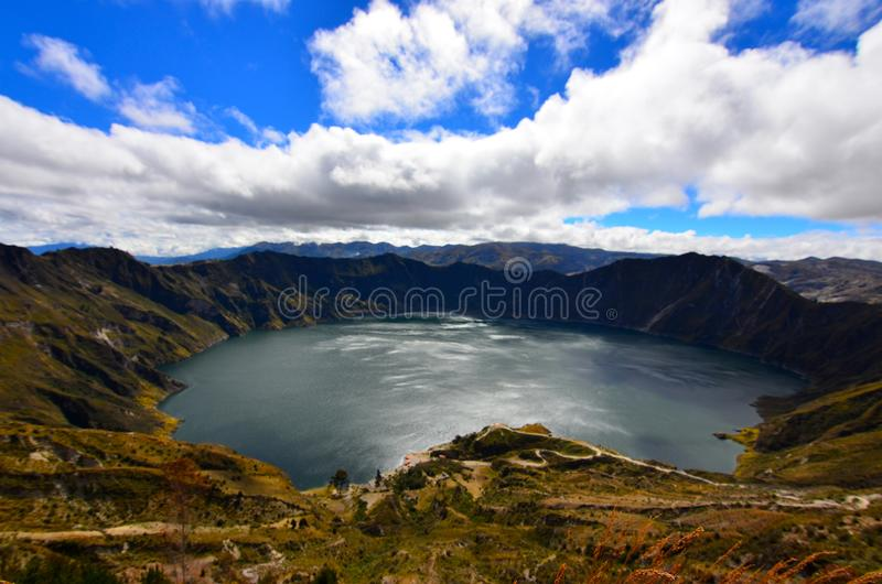 Laguna Quilotoa, Ecuador. Quilotoa is a lake filled caldera in the Andes in Ecuador.  The three kilometre wide caldera was created when the dacite volcano stock images
