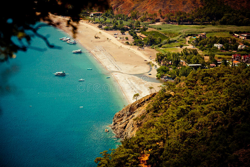 Laguna and sea with boat view from mountain. Summer time laguna in Turkey stock photos