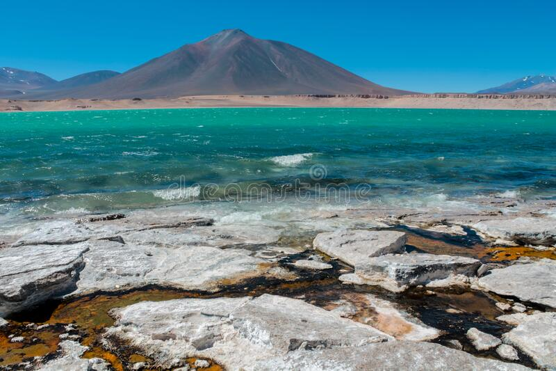 Laguna Verde green water lagoon lake and volcano in Chile mountains of Altiplano. In South America Andes mountains near Ojos del Salado highest volcano in the royalty free stock images