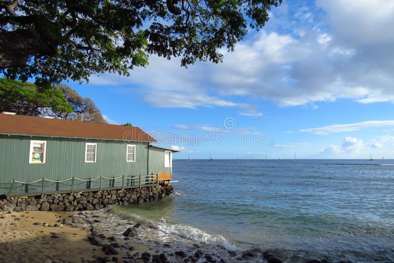 Lahaina house looking out over the Pacific Ocean, Maui, Hawaii. House in Lahaina historic town at the shore of the Pacific Ocean, Maui, Hawaii royalty free stock photos