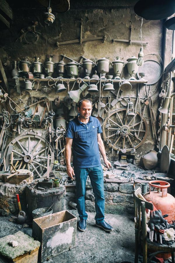 Portrait of Blacksmith from Lahic. Copper production and utensils in Lahiche - the center of handicraft production stock photos