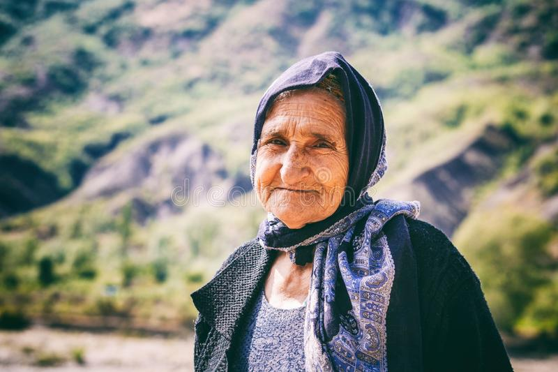 Portrait of old woman living in the oldest building in Lahich, located on the mountain in Lahic royalty free stock images