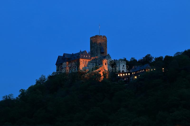 Lahneck Castle above Lahnstein on the Lahn estuary illuminated in the evening. Castle Lahneck above Lahnstein on the Lahn estuary in the Rhine royalty free stock photo