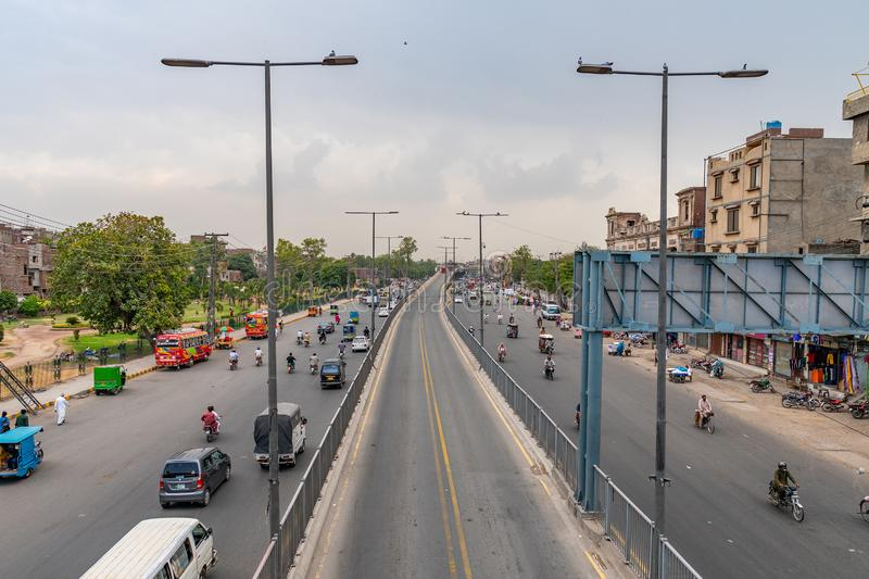 Lahore Data Darbar Road 186. Lahore Data Darbar Road Picturesque View with Busy Traffic on a Cloudy Blue Sky Day stock photography