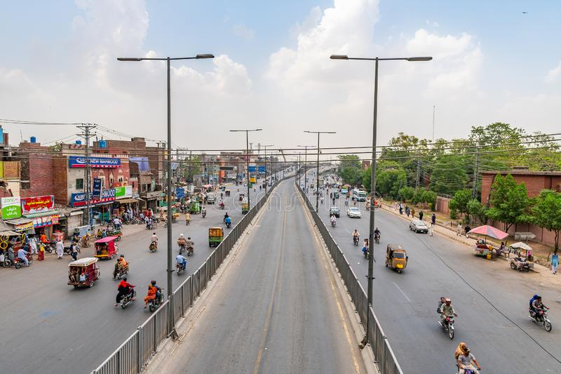 Lahore Data Darbar Road 187. Lahore Data Darbar Road Picturesque View with Busy Traffic on a Cloudy Blue Sky Day royalty free stock images