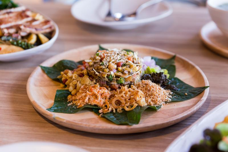 Lahpet is Burmese Tea Leaf Salad served with deep fried garlic, peanut, white sesame, dried shrimp, ginger and roasted coconut.  royalty free stock photos