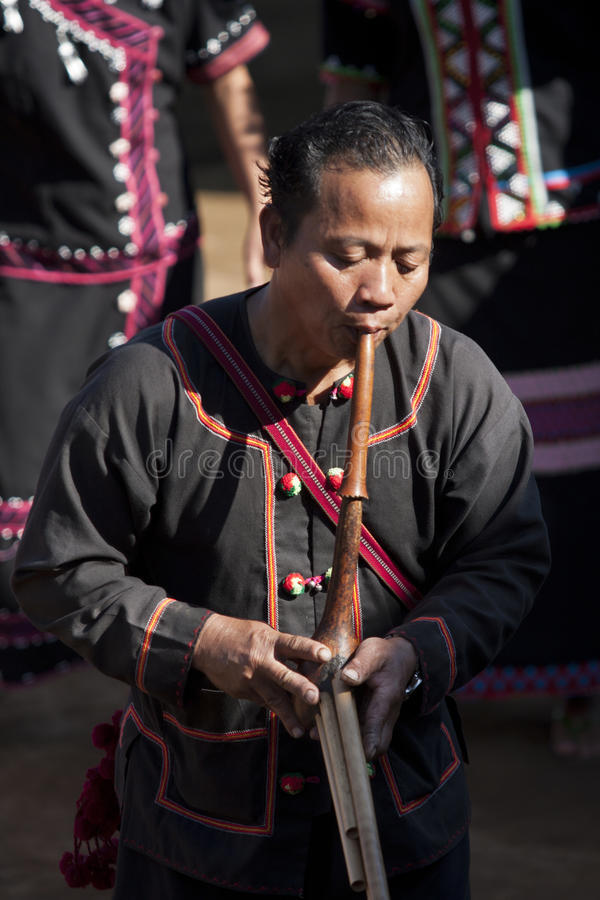Lahu play traditional musical instrument. Lahu tribe man plays traditional musical instrument, Doi Pumeun village near to Myanmar border in Mae Ai distric stock images