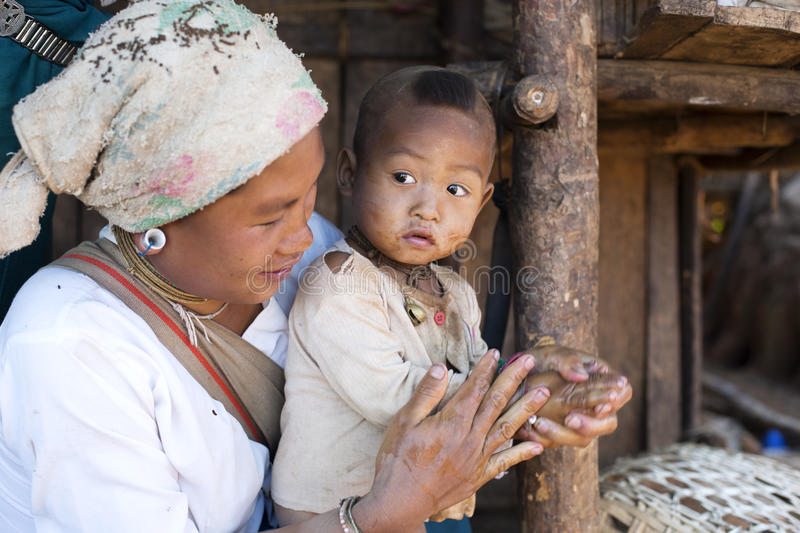 Lahu Shi Tribe, Myanmar. Kengtung, Myanmar - January 21, 2016. A portrait of a woman and child from the Lahu Shi tribe. They are a self sufficient Buddhist tribe royalty free stock photos