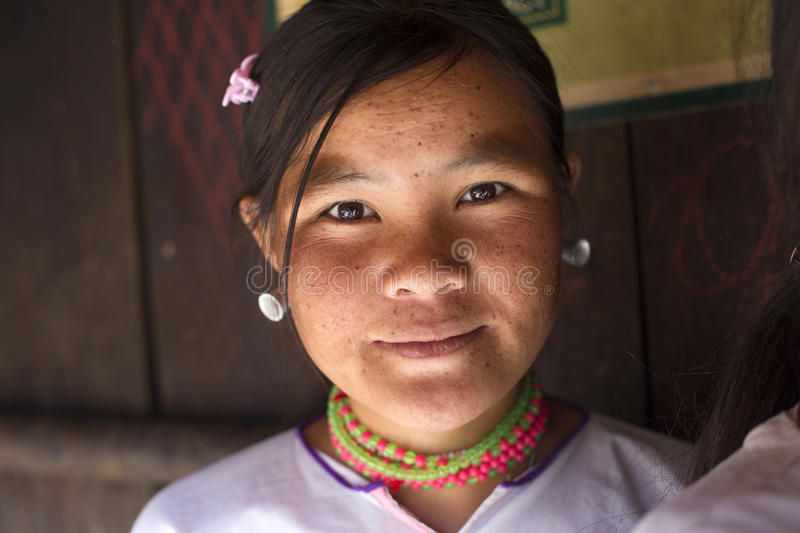Lahu Shi Tribe, Myanmar. Kengtung, Myanmar - January 21, 2016. A portrait of a young girl from the Lahu Shi tribe. They are a self sufficient Buddhist tribe who stock image