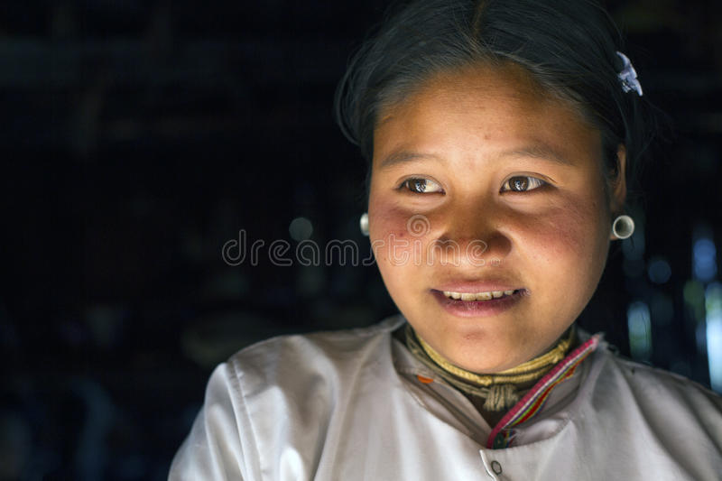 Lahu Shi Tribe, Myanmar. Kengtung, Myanmar - January 21, 2016. A portrait of a young girl from the Lahu Shi tribe. They are a self sufficient Buddhist tribe who stock images