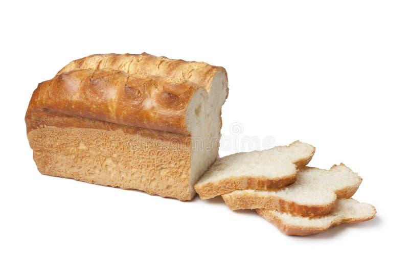 Laib des weißen Brotes mit Scheiben lizenzfreie stockbilder