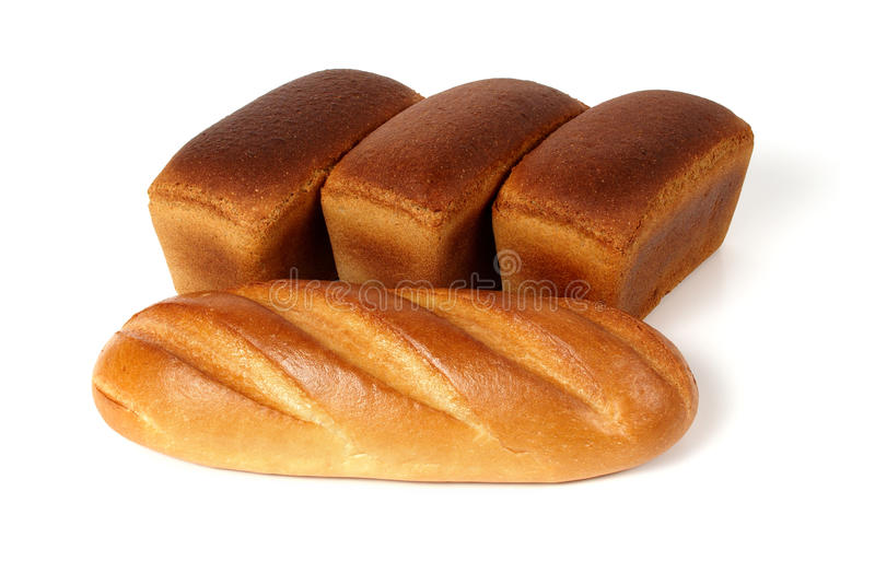 Laib des weißen Brotes und drei Laibe Roggenbrotes lizenzfreie stockfotos