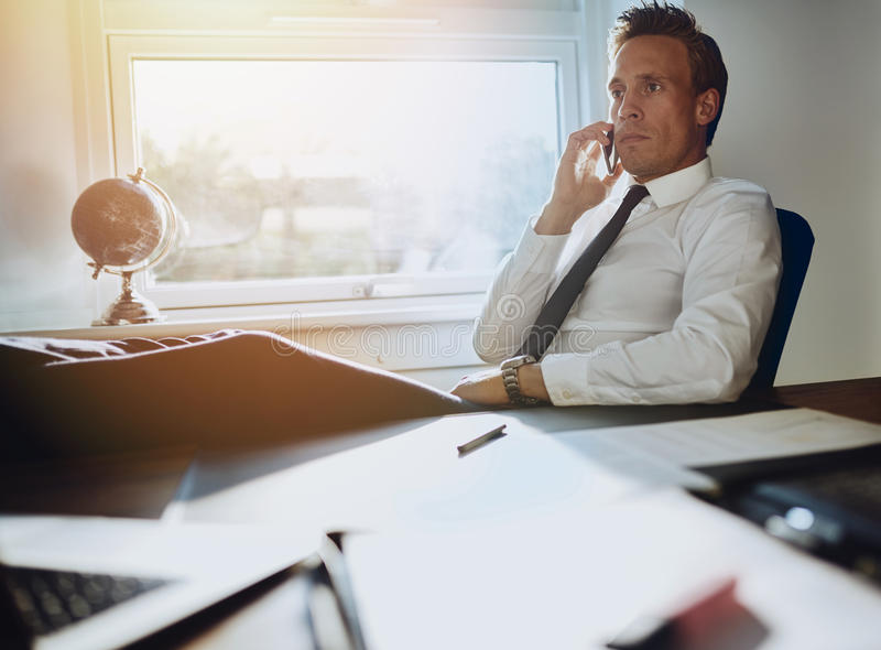 Laid back confident business man royalty free stock photo
