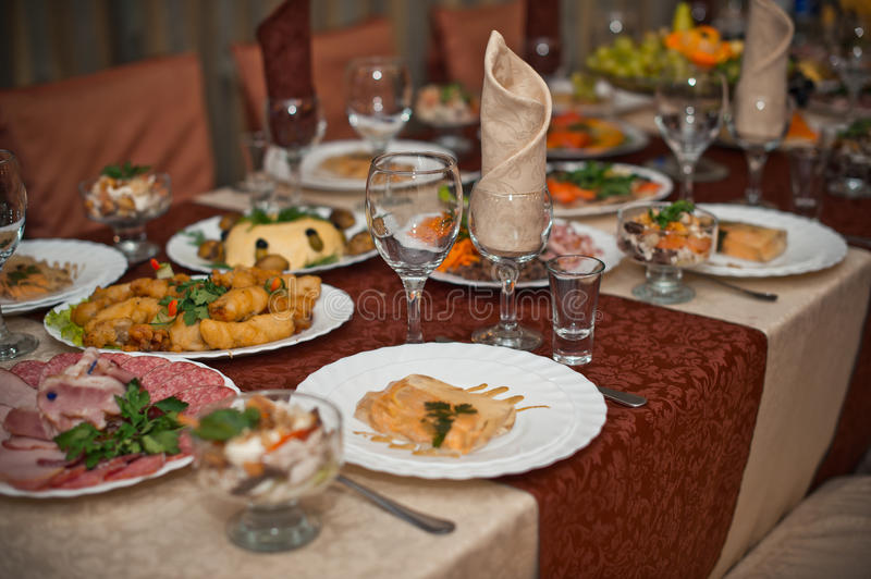 Laid the table. The table ready for carrying out a holiday with established dishes stock photo