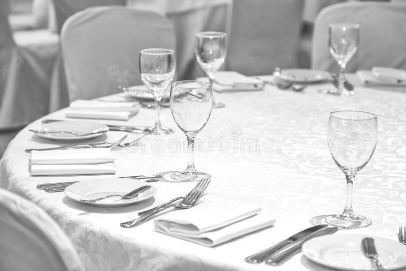 Laid table in restaurant. A photo of place settings laid out on a restaurant table royalty free stock photo