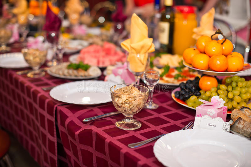 Laid the table 6. Table with the spread-out devices and food stock photos