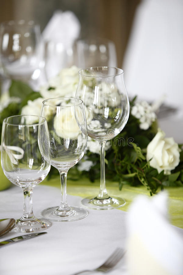 Laid wedding table. With flowers stock photo