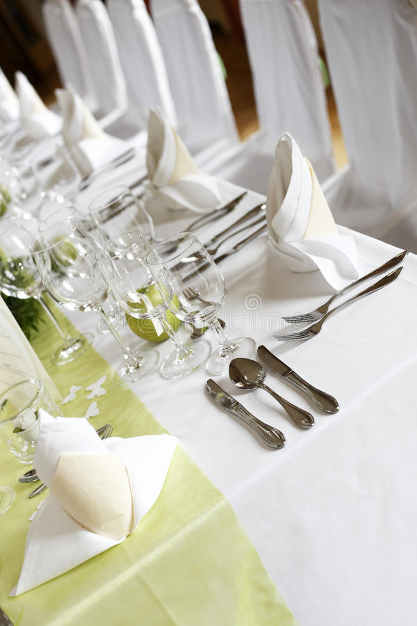 Laid wedding table. With flowers stock photography