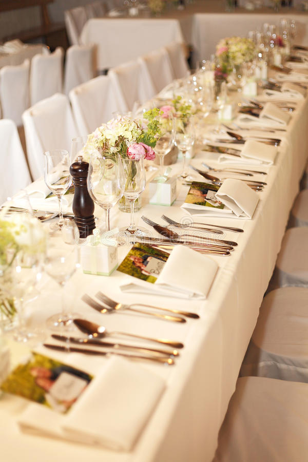 Laid wedding table. With flowers royalty free stock image
