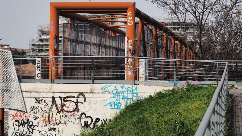 Lainate iron bridge with grafiiti paint. royalty free stock images