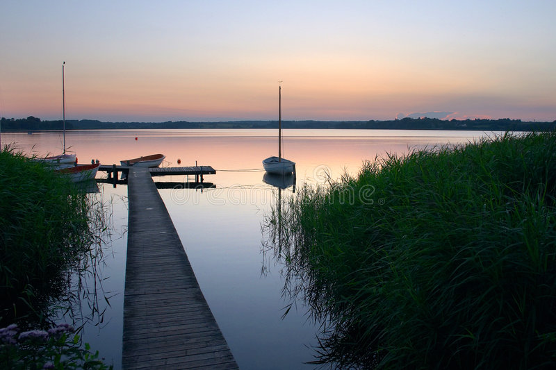 Lake. A lake in denmark , a so called bath bridge on a danish lake at the sunset stock image