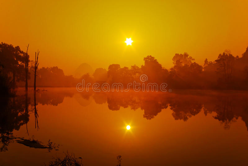 Lake. Sun reflection in the lake, the lake has a layer of mist royalty free stock image