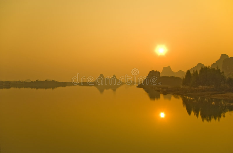 Lake. The sun reflected in the lake, the formation of a perfect picture royalty free stock photos