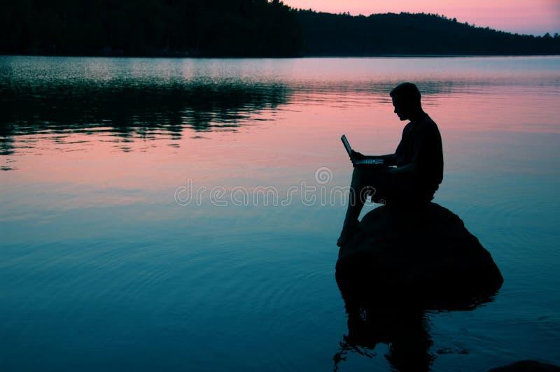 Download Lake arkivfoto. Bild av workaholic, kommunikationer, sitting - 982898