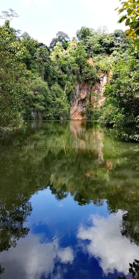 Lake at abandoned quarry. Lake at disused quarry. In Bukit Batok nature park in Singapore royalty free stock photography