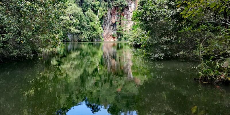 Lake at abandoned quarry. Lake at disused quarry. In Bukit Batok nature park in Singapore royalty free stock photos