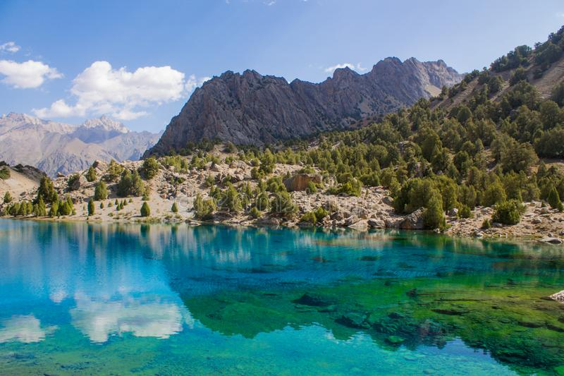 Lake Alaudin in Fan mountains in Pamir, Tajikistan. Scenic landscape in Fan mountains in Pamir, Tajikistan. Beautiful rocky peaks and crystal blue lake Big Allo stock image