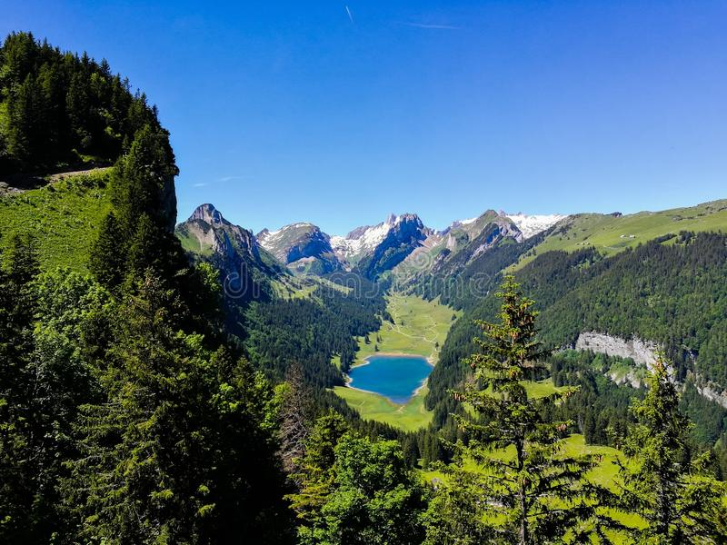 Lake in alpine valley stock photography