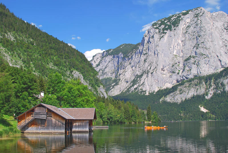 Lake Altaussee,Styria,Austria. The lake altaussee with typical wooden boat,styria,austria royalty free stock photography