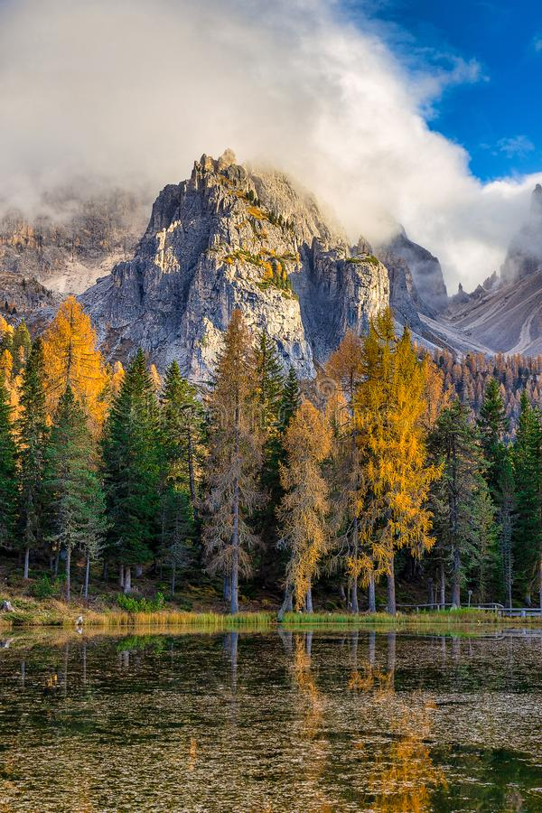 Lake Antorno in Dolomite Alps and colorful trees in autumn season royalty free stock images