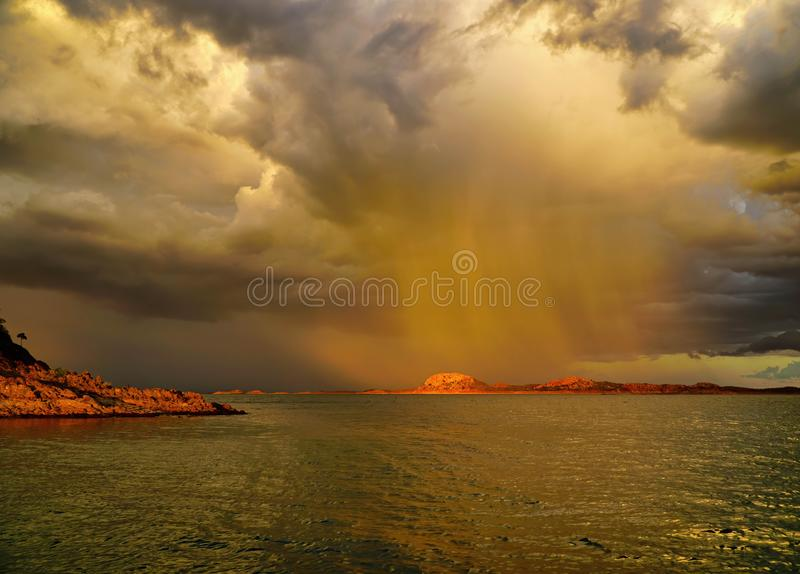Lake Argyle is Western Australia on a tropical rainy day. Lake Argyle is Western Australia is part of the Ord River Irrigation Scheme and is located near the royalty free stock images