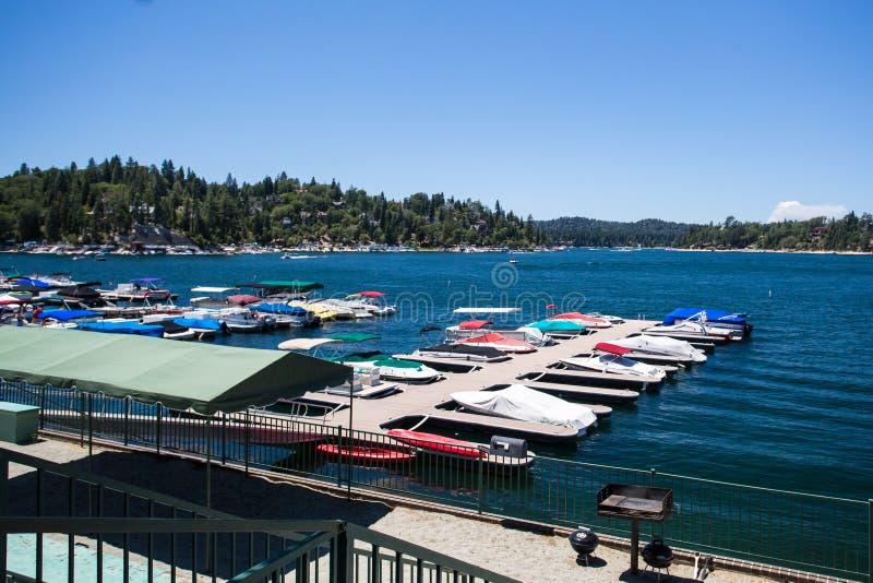 Lake Arrowhead Shoreline. Lake Arrowhead with boats moored on a hot summer's day near Los Angeles, California, USA royalty free stock images