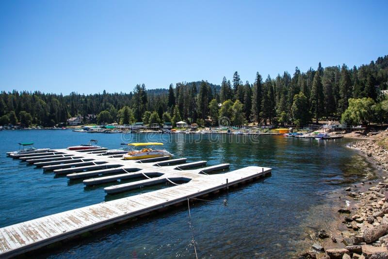 Lake Arrowhead Shoreline. Lake Arrowhead, USA - 16th August 2015: Lake Arrowhead with boats moored on a hot summer`s day near Los Angeles, California, USA stock photography