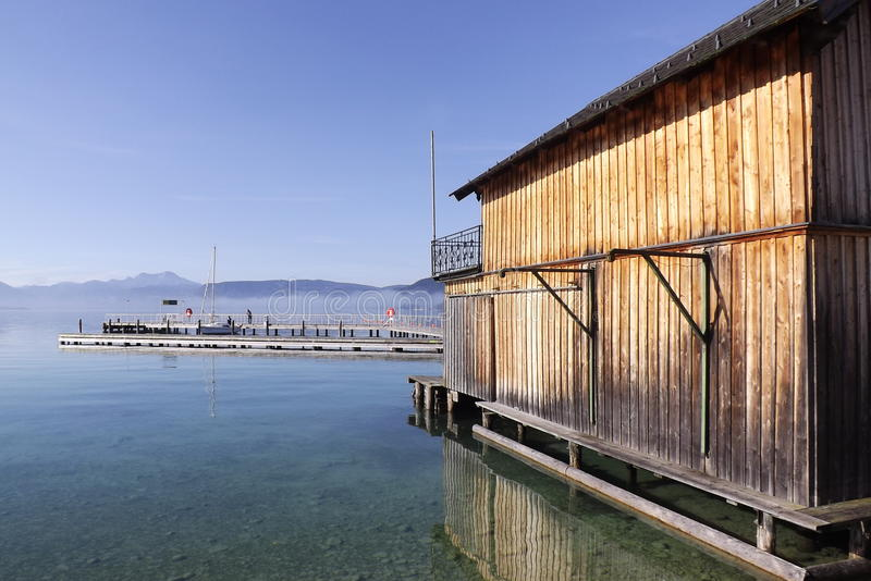 The Lake Attersee in Austria, Europe. A boathouse in the morning sun at the lakefront of Seewalchen stock photo