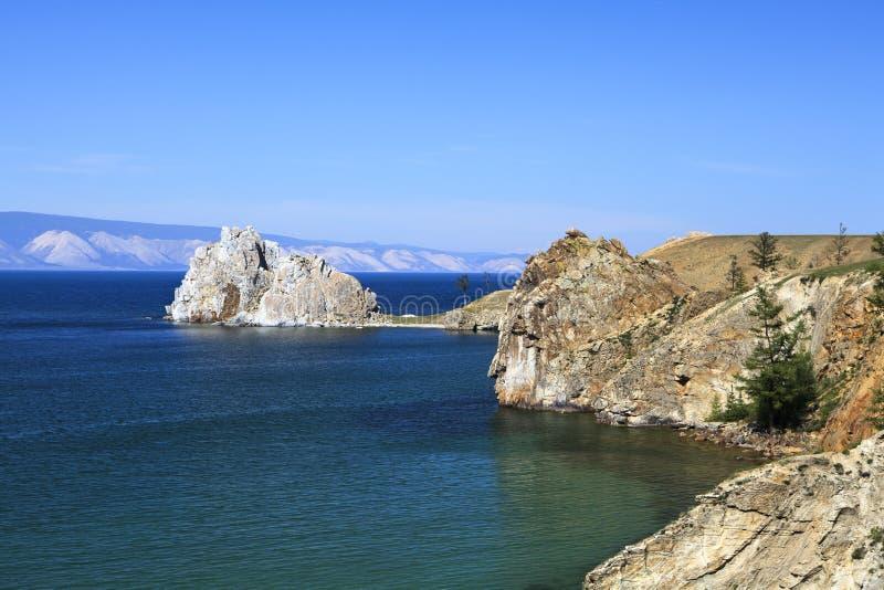Lake Baikal. Cape Burhan and Shaman Rock on Olkhon Island at Baikal Lake, Russia stock photos