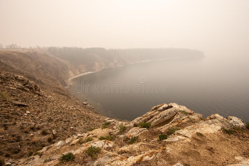 Lake Baikal in the fog in the morning. stock images