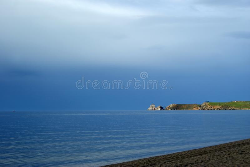 Lake Baikal & Shamanka rock Cape Burkhan royalty free stock image