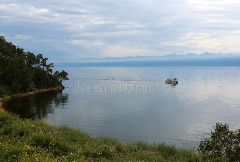 Water. Baikal. Beauty of this world. Knowledge of nature. Through the eyes of nature. Amazing photo for background. Lake Baikal, Siberia. Leisure at sea. Beauty stock photography
