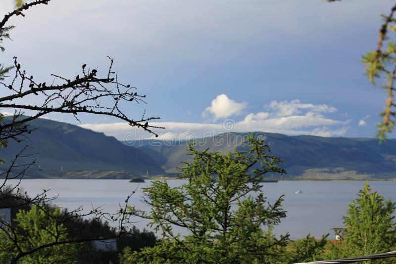 Lake Baikal Sarma groge litle sea. Lake Baikal the strait little sea trees. The groge Sarma wind Sarma Clouds mountines royalty free stock photos