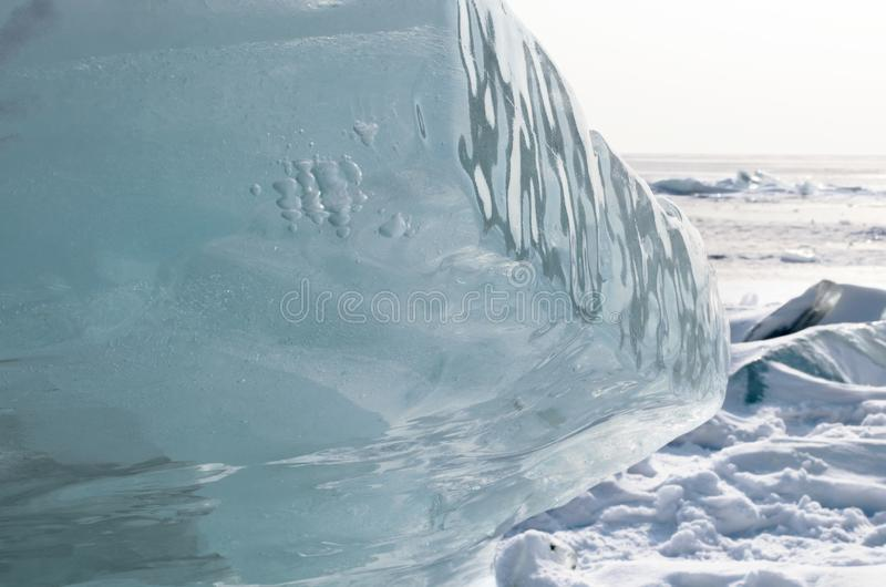 Lake Baikal in winter. Pure blue floe on snowy surface royalty free stock photos